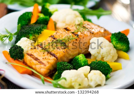 Fillet of salmon with cooked vegetables - stock photo