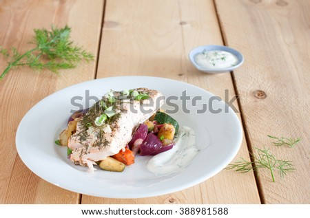 Fillet of salmon with roasted vegetables and yogurt dip - stock photo