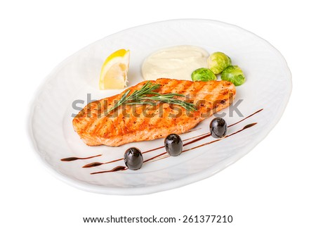 Fillet of salmon with vegetables on a white isolated background - stock photo