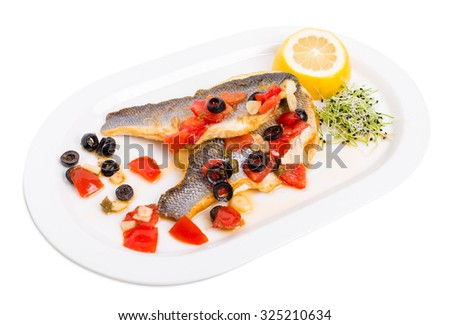 Fillet of seabass on a baked potato with capers and tomatoes. Isolated on a white background. - stock photo