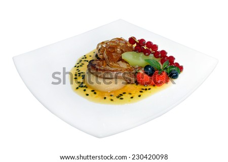fillet of turkey with sauce and fruits isolated on white background  - stock photo