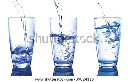 filling a glass of water isolated on white background