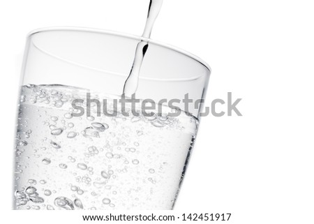 filling a glass with pure water with bubbles and space for text on white background