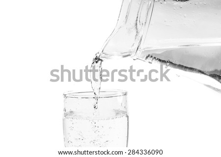 Filling a glass with water showing a drink concept - stock photo