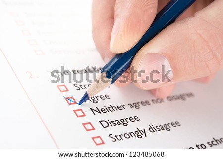 """Filling """"Agree"""" checkbox of questionnaire - stock photo"""