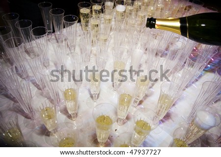 Filling Champagne Glasses Ready For Reception