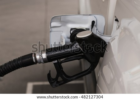 Filling gas at the station. Fill the gas tank. Self service. Gas pump in the car. Refill oil, gasoline, diesel vehicle