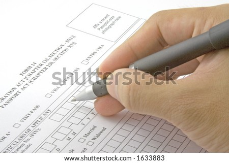 Filling in an application form for visa entry - stock photo