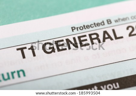 Filling in canadian individual tax form T1 for year 2013 - stock photo