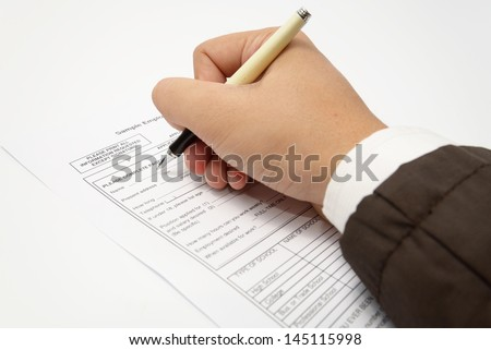 Filling in personal details on an application form - stock photo