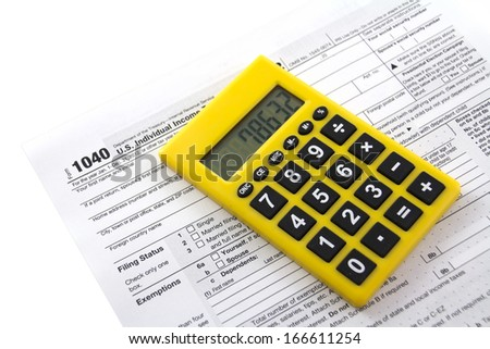 Filling in tax form 1040  - stock photo
