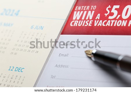 Filling in your information to win vacation - stock photo