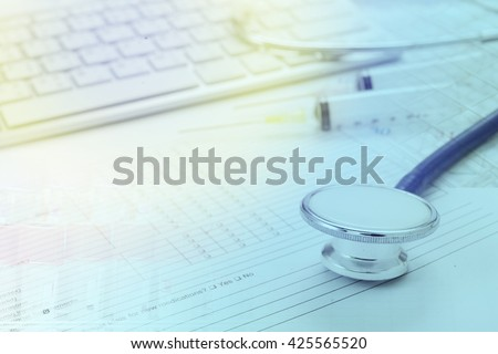 Filling Medical Form, document, stethoscope - stock photo
