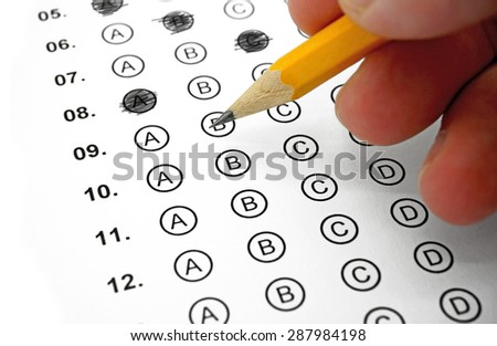 Filling out Answers on a Multiple Choice Test - stock photo