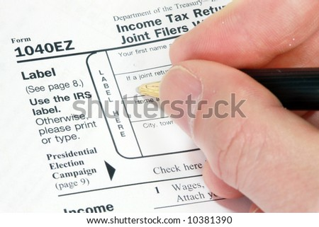 Filling out 1040EZ Form for tax return - stock photo