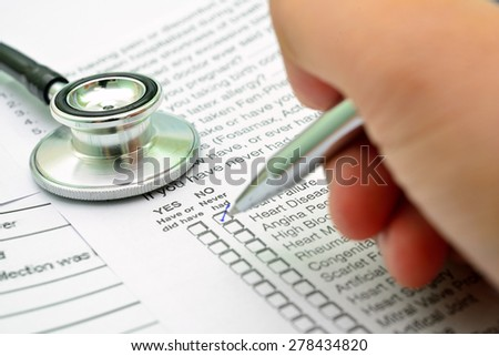 Filling the Family History section in the medical history questionnaire - stock photo
