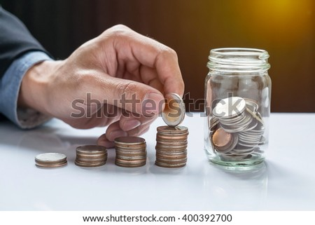 filling up coins to coin piles and glass for investment in the future.