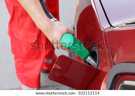 Filling up of  fuel at petrol station - stock photo