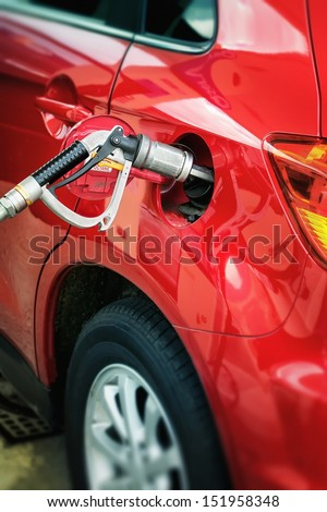 Filling up of liquid gas, LPG at petrol station  - stock photo