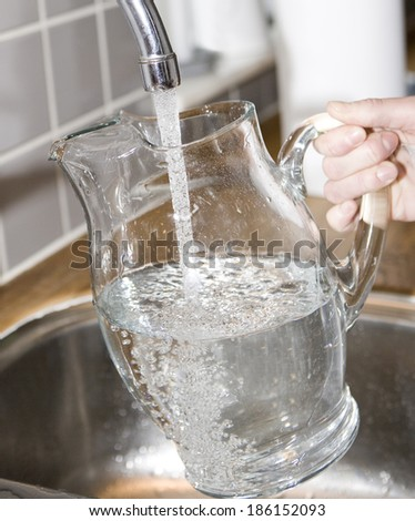 Filling water in a Glass Carafe