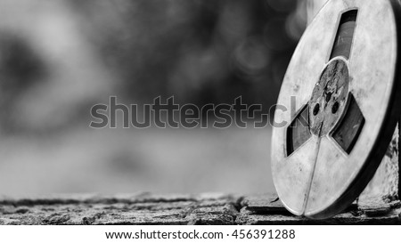 film canister reel black and white - stock photo