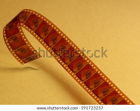 Film celluloid over a yellow background. Horizontal