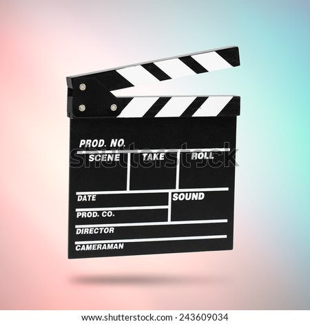 Film Clapboard on cinematic background - stock photo