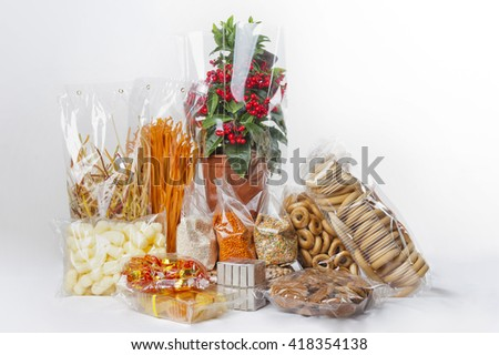 Film for food packaging. Products wrapped in plastic - stock photo