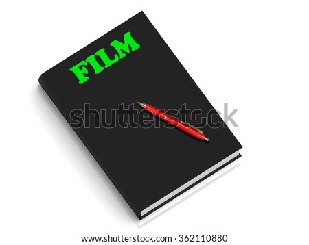 FILM- inscription of green letters on black book on white background