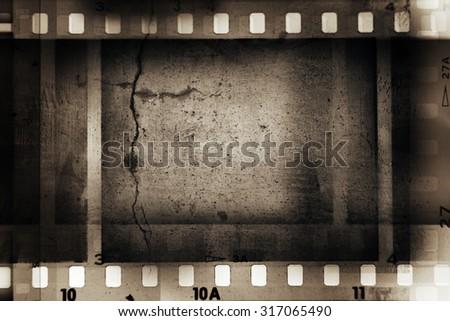 Film negative frames on grunge background - stock photo