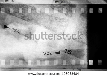 Film negatives overlapping, black and white - stock photo
