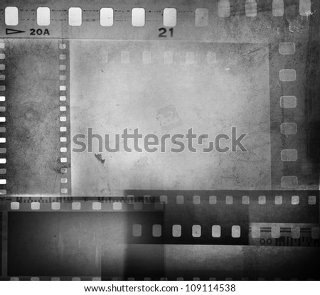 Film negatives overlapping, copy space - stock photo