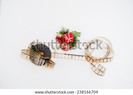 Film reel with christmas decoration isolated on white background - stock photo