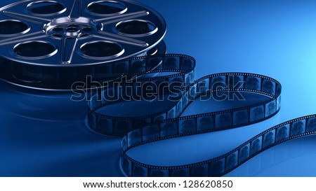 Film reel with filmstrip - stock photo