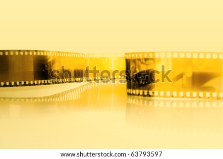 Film strip background with yellow photo filter . - stock photo
