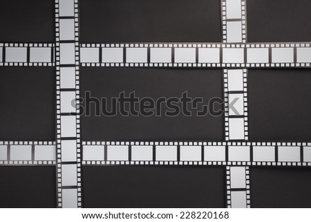 Film stripes on a black background with copy space - stock photo