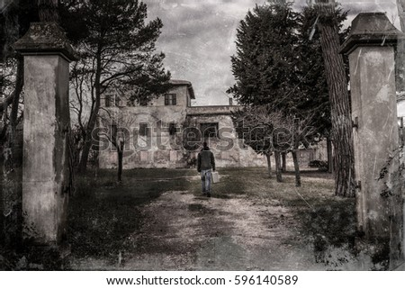 Film Vintage Filter Young Man With A Suitcase Walking In Front Of Creepy Old