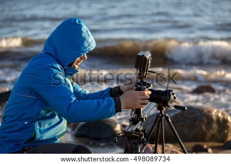 filming on the beach, tripods and slider