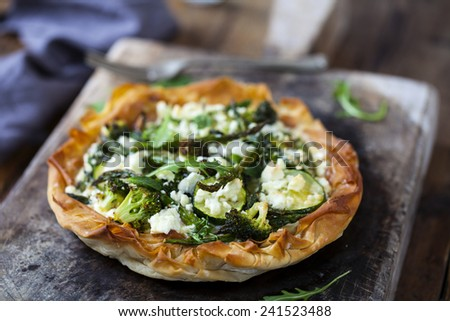 Filo pastry tart with courgette, broccoli and asparagus tips - stock photo