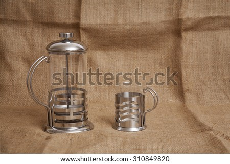 Filter Coffee Press and Glass Cup on Wicker Cloth