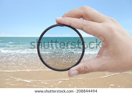 Filter held against the beach giving clarity  - stock photo