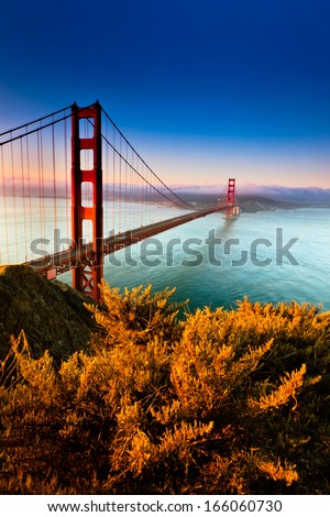 Filtered morning light illuminates the famous Golden Gate Bridge in San Francisco, California.   - stock photo