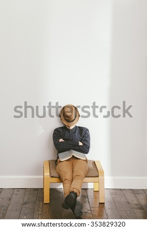 filtered photo of a young stylish man having a nap - stock photo
