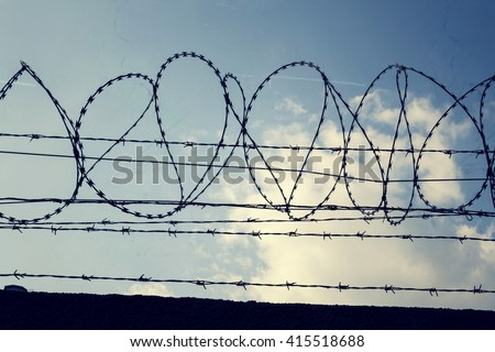 Filtered Vintage Picture Of Barbed Wire Fence Detail  R