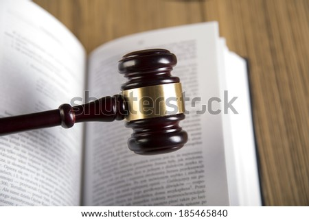 Final speech, notebook, wooden & gold gavel and books on wooden table on brown wooden background