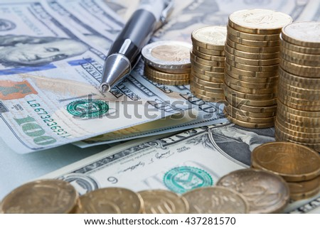 Finance background with money Dollar and Euro have a Pen analyzing finance market. Finance concept. - stock photo