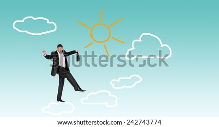 Finance business.Man on clouds - stock photo