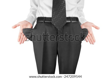 finance concept - bankrupt business man showing empty pockets  hands - stock photo