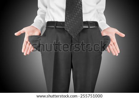 finance concept - bankrupt business man showing empty pockets  hands - stock photo