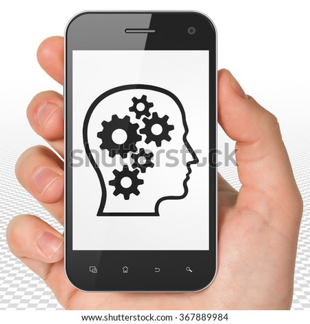 Finance concept: Hand Holding Smartphone with Head With Gears on display - stock photo